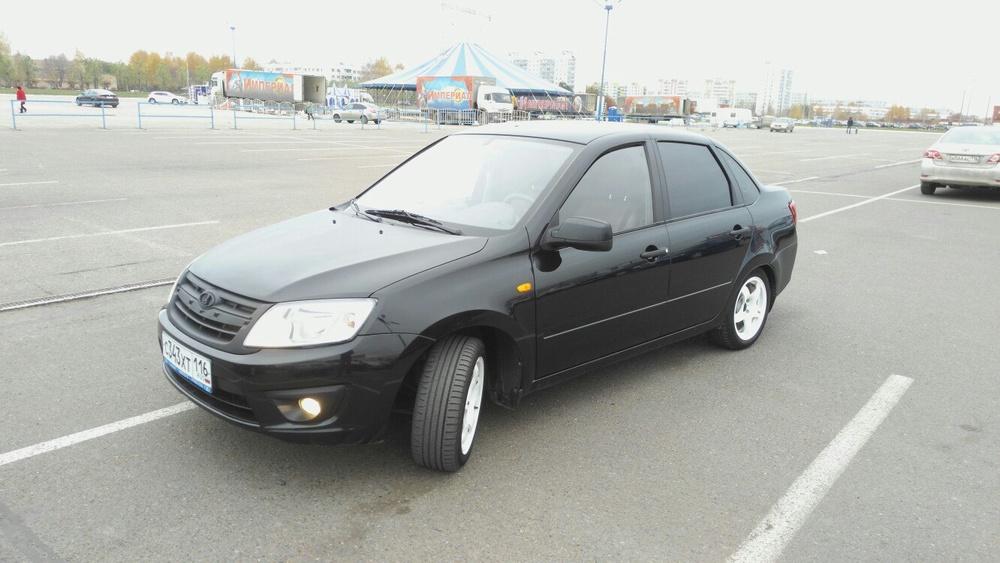Подержанный ВАЗ (Lada) Granta, отличное состояние, черный металлик, 2013 года выпуска, цена 239 999 руб. в республике Татарстане