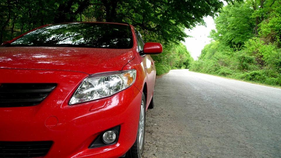 Подержанный Toyota Corolla, отличное состояние, красный металлик, 2008 года выпуска, цена 400 000 руб. в Челябинской области