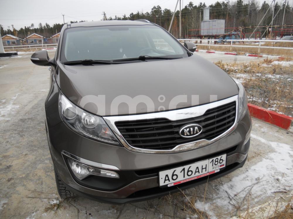 Подержанный Kia Sportage, хорошее состояние, коричневый , 2010 года выпуска, цена 700 000 руб. в ао. Ханты-Мансийском Автономном округе - Югре