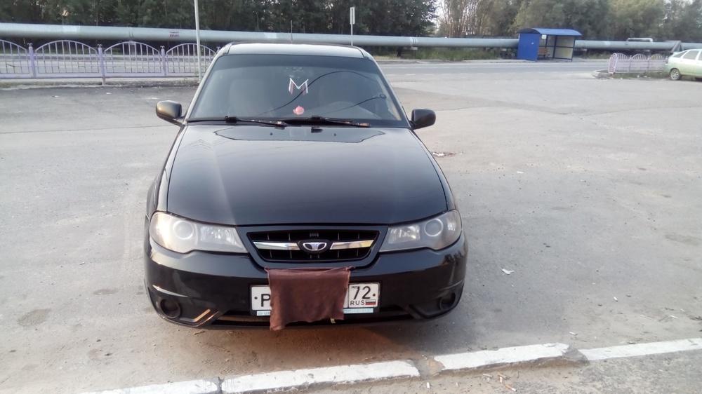 Подержанный Daewoo Nexia, отличное состояние, черный , 2012 года выпуска, цена 200 000 руб. в ао. Ханты-Мансийском Автономном округе - Югре