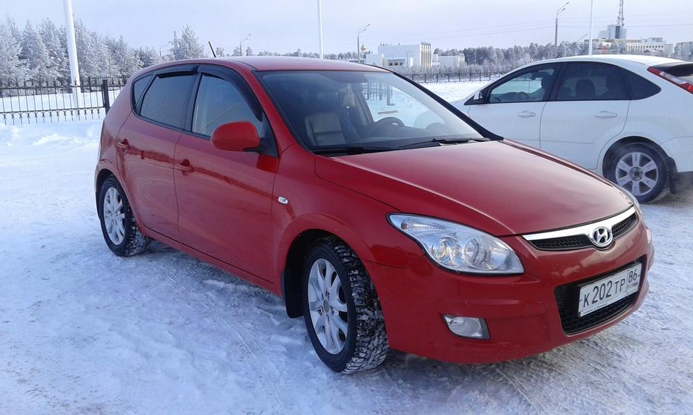 Подержанный Hyundai i30, хорошее состояние, красный металлик, 2009 года выпуска, цена 350 000 руб. в ао. Ханты-Мансийском Автономном округе - Югре