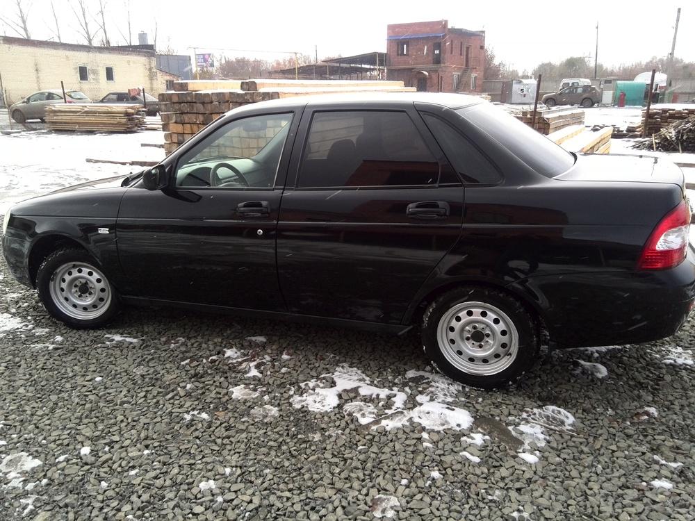 Подержанный ВАЗ (Lada) Priora, хорошее состояние, черный , 2011 года выпуска, цена 220 000 руб. в Челябинской области