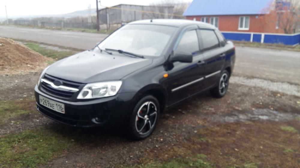 Подержанный ВАЗ (Lada) Granta, отличное состояние, черный , 2012 года выпуска, цена 260 000 руб. в республике Татарстане