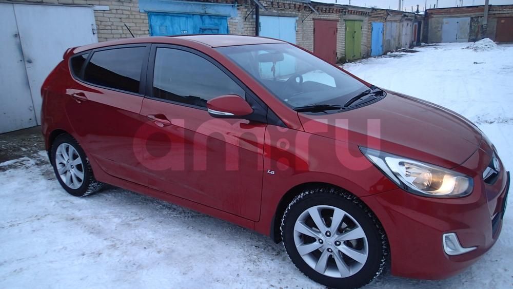 Подержанный Hyundai Solaris, отличное состояние, красный металлик, 2011 года выпуска, цена 470 000 руб. в Челябинской области