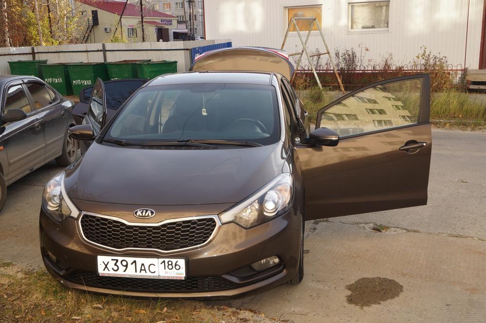 Подержанный Kia Cerato, хорошее состояние, коричневый , 2013 года выпуска, цена 780 000 руб. в ао. Ханты-Мансийском Автономном округе - Югре