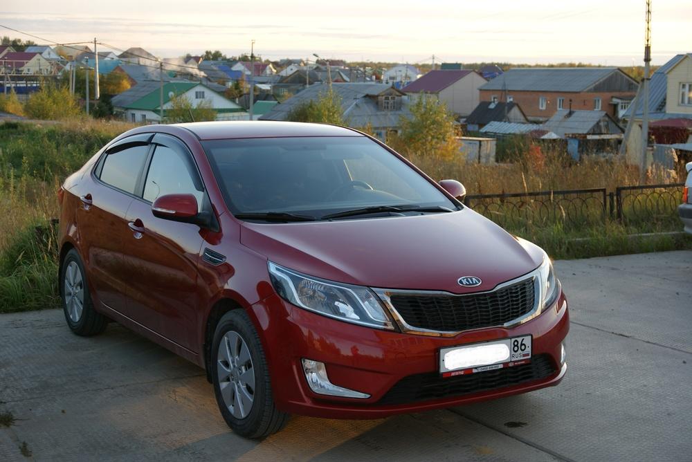 Подержанный Kia Rio, хорошее состояние, красный , 2012 года выпуска, цена 540 000 руб. в ао. Ханты-Мансийском Автономном округе - Югре