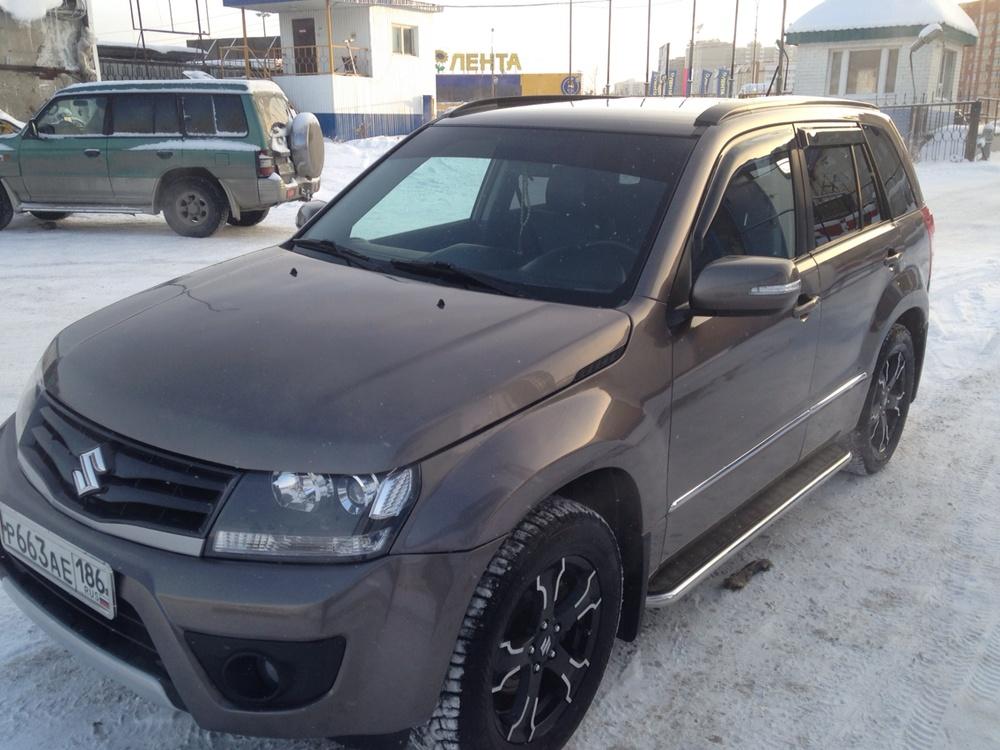 Подержанный Suzuki Grand Vitara, отличное состояние, бронзовый металлик, 2013 года выпуска, цена 1 140 000 руб. в ао. Ханты-Мансийском Автономном округе - Югре