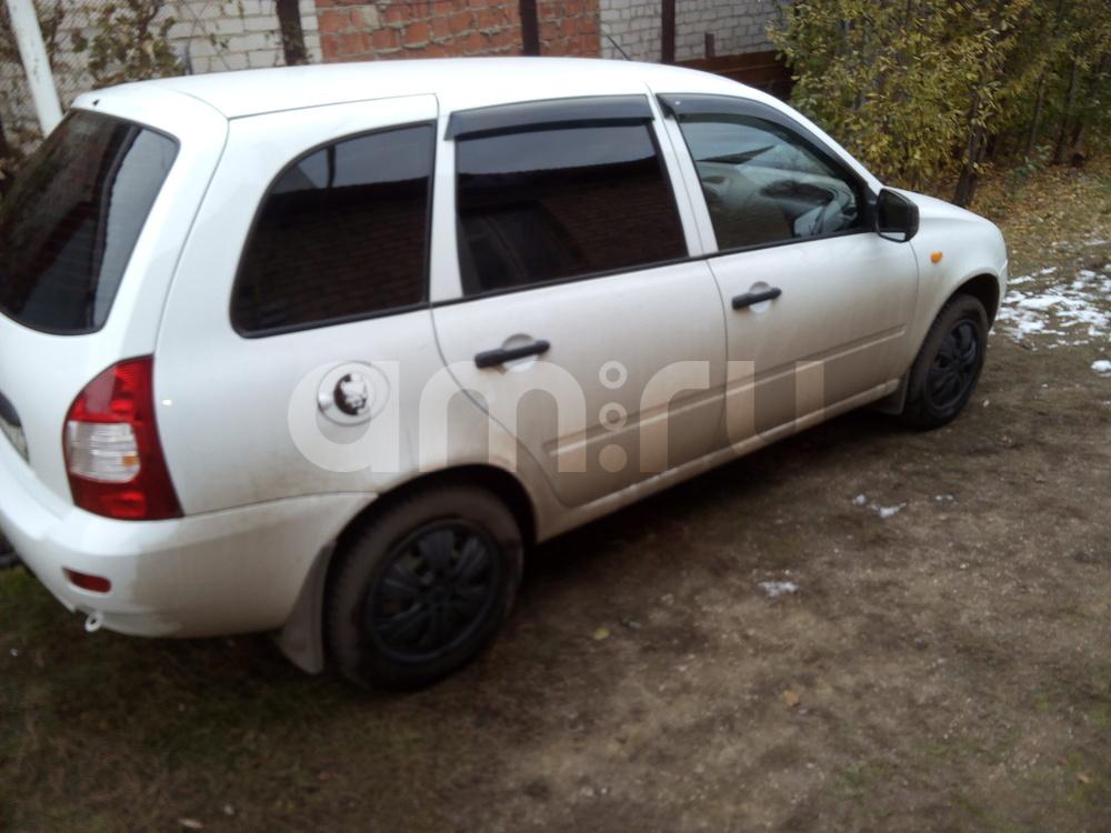 Подержанный ВАЗ (Lada) Kalina, отличное состояние, белый , 2012 года выпуска, цена 230 000 руб. в Челябинской области