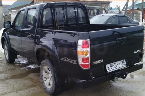 Подержанный Mazda BT-50, отличное состояние, зеленый , 2010 года выпуска, цена 710 000 руб. в ао. Ханты-Мансийском Автономном округе - Югре