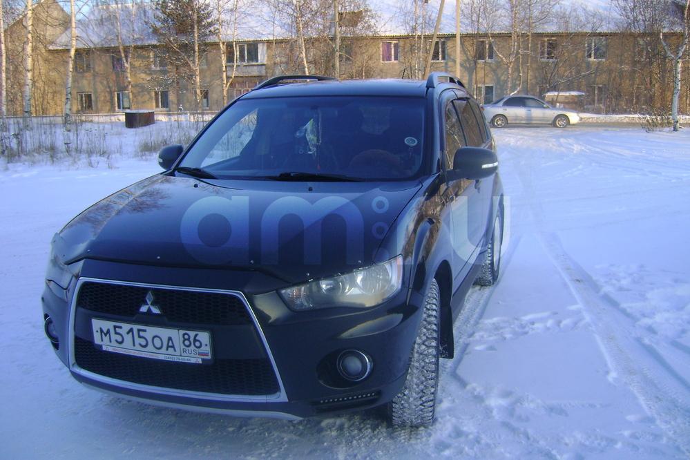 Подержанный Mitsubishi Outlander, отличное состояние, черный , 2011 года выпуска, цена 830 000 руб. в ао. Ханты-Мансийском Автономном округе - Югре