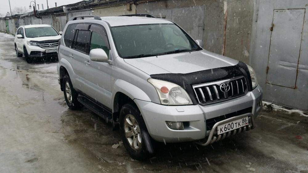 Подержанный Toyota Land Cruiser Prado, хорошее состояние, серебряный металлик, 2006 года выпуска, цена 1 280 000 руб. в ао. Ханты-Мансийском Автономном округе - Югре