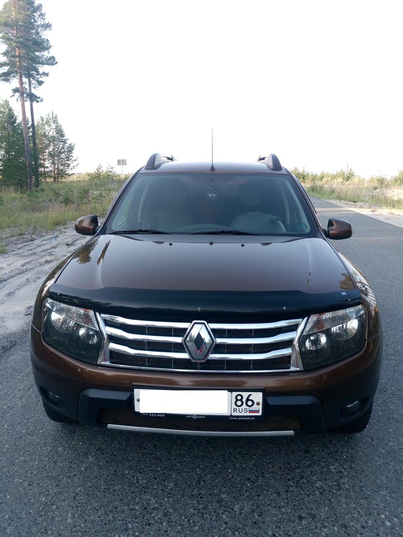 Подержанный Renault Duster, отличное состояние, коричневый металлик, 2012 года выпуска, цена 650 000 руб. в ао. Ханты-Мансийском Автономном округе - Югре