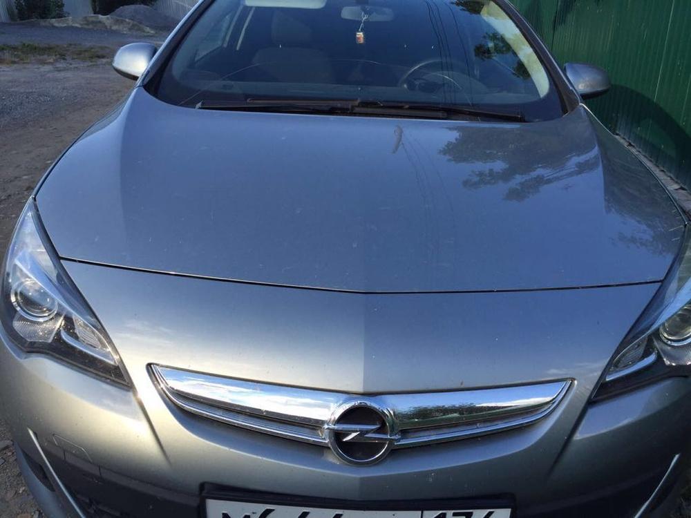 Подержанный Opel Astra, отличное состояние, серый , 2012 года выпуска, цена 720 000 руб. в Челябинской области