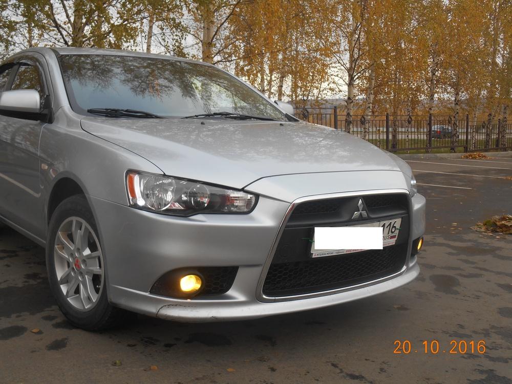 Подержанный Mitsubishi Lancer, хорошее состояние, серебряный перламутр, 2012 года выпуска, цена 520 000 руб. в республике Татарстане