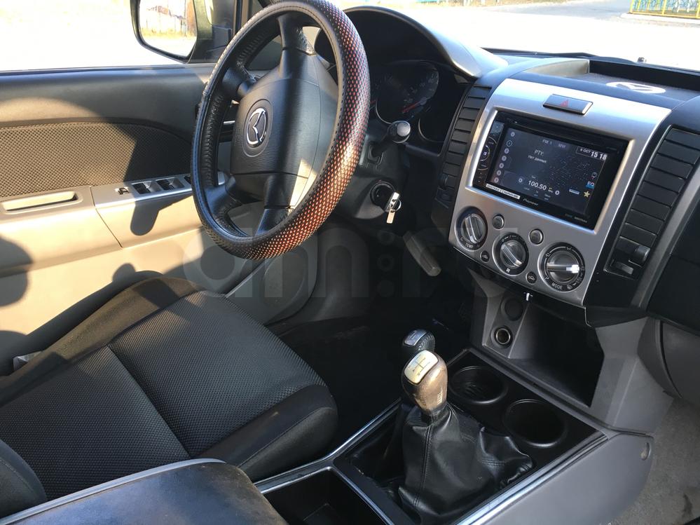 Подержанный Mazda BT-50, отличное состояние, коричневый , 2010 года выпуска, цена 780 000 руб. в ао. Ханты-Мансийском Автономном округе - Югре