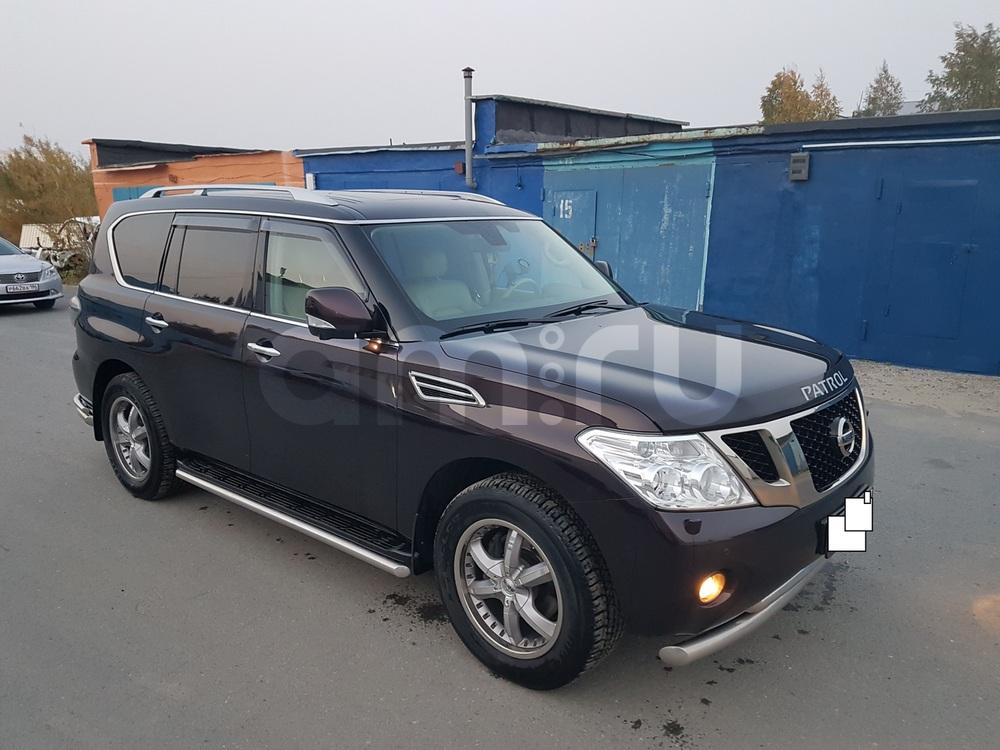 Подержанный Nissan Patrol, хорошее состояние, бордовый , 2011 года выпуска, цена 2 000 000 руб. в ао. Ханты-Мансийском Автономном округе - Югре