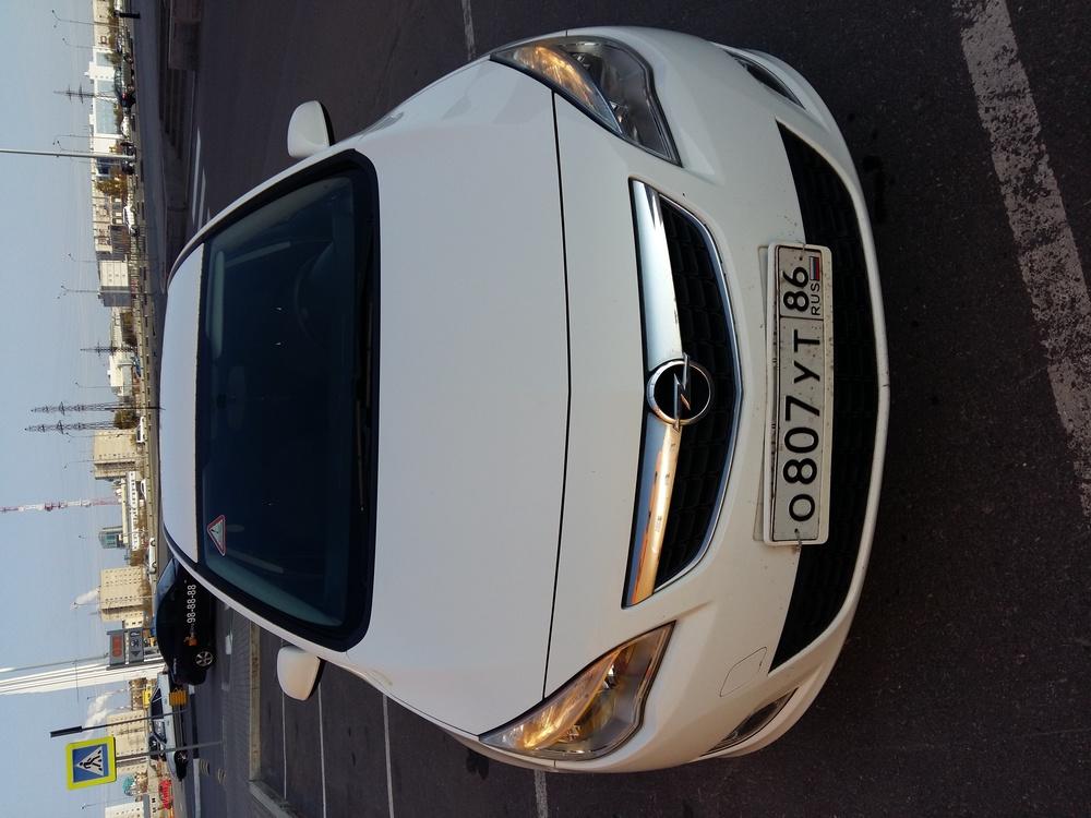Подержанный Opel Astra, хорошее состояние, белый акрил, 2011 года выпуска, цена 555 000 руб. в ао. Ханты-Мансийском Автономном округе - Югре
