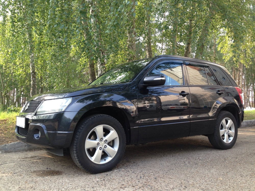 Подержанный Suzuki Grand Vitara, хорошее состояние, черный , 2011 года выпуска, цена 830 000 руб. в республике Татарстане