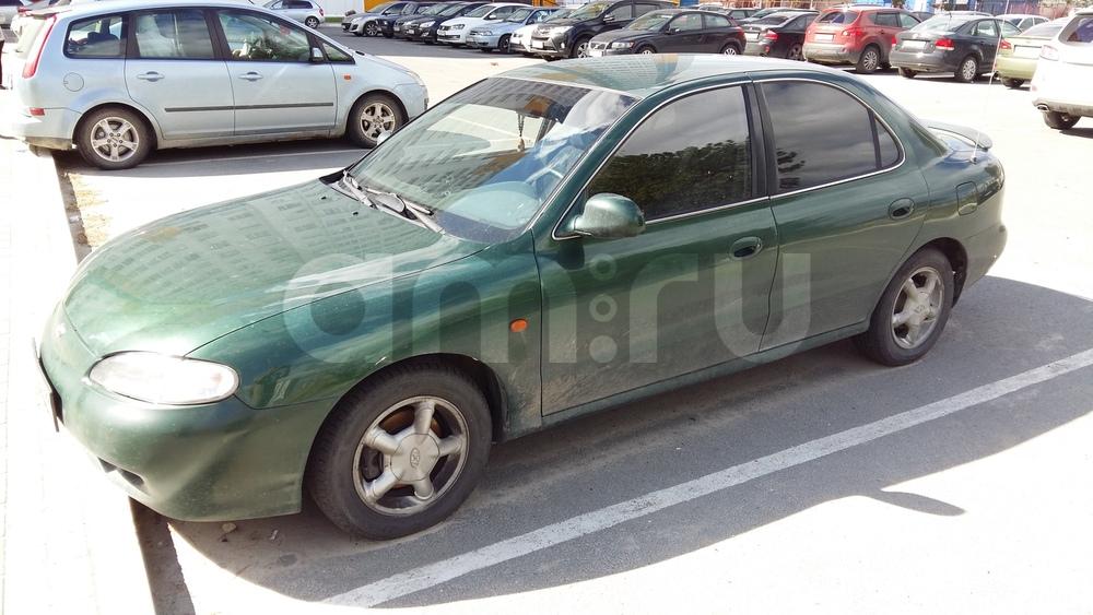 Подержанный Hyundai Lantra, хорошее состояние, зеленый металлик, 1997 года выпуска, цена 220 000 руб. в ао. Ханты-Мансийском Автономном округе - Югре