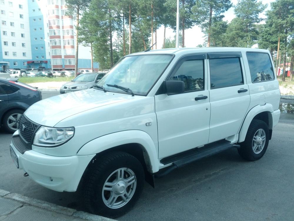Подержанный УАЗ Patriot, отличное состояние, белый , 2014 года выпуска, цена 600 000 руб. в ао. Ханты-Мансийском Автономном округе - Югре