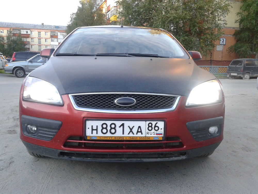 Подержанный Ford Focus, хорошее состояние, красный , 2006 года выпуска, цена 260 000 руб. в ао. Ханты-Мансийском Автономном округе - Югре