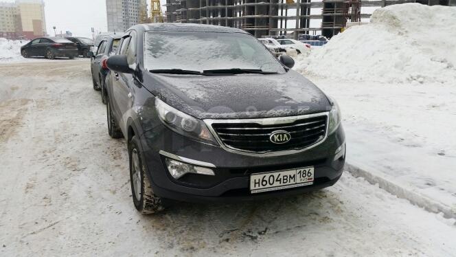 Подержанный Kia Sportage, отличное состояние, мокрый асфальт , 2015 года выпуска, цена 1 150 000 руб. в ао. Ханты-Мансийском Автономном округе - Югре