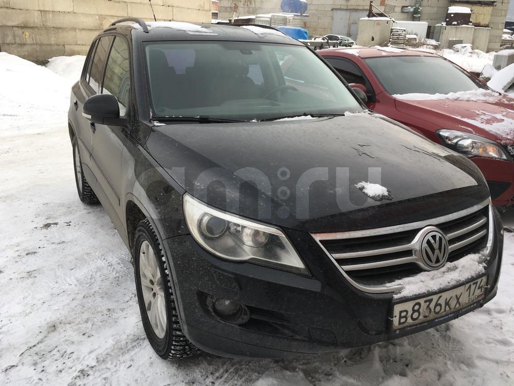 Подержанный Volkswagen Tiguan, хорошее состояние, черный , 2009 года выпуска, цена 710 000 руб. в Челябинской области