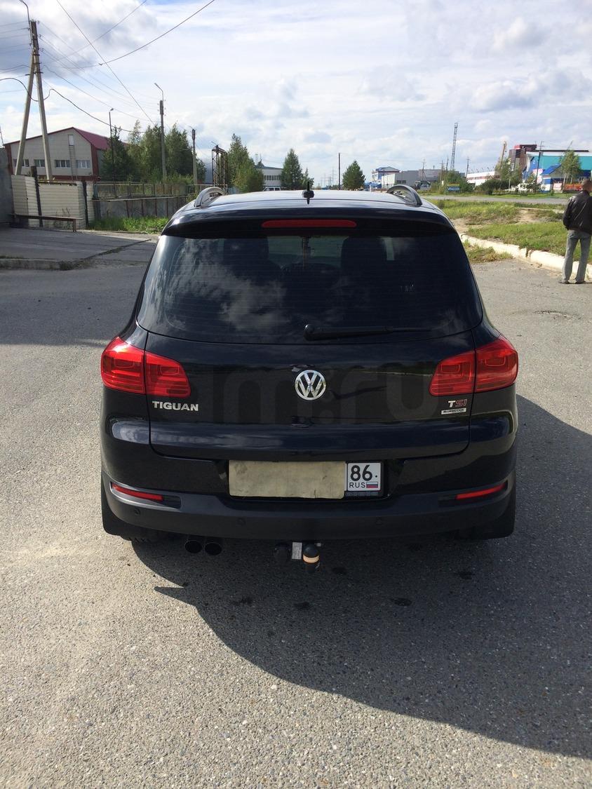 Подержанный Volkswagen Tiguan, отличное состояние, черный , 2013 года выпуска, цена 1 170 000 руб. в ао. Ханты-Мансийском Автономном округе - Югре