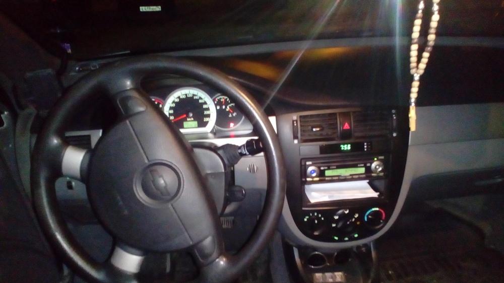 Подержанный Chevrolet Lacetti, хорошее состояние, серебряный металлик, 2012 года выпуска, цена 359 000 руб. в Челябинской области