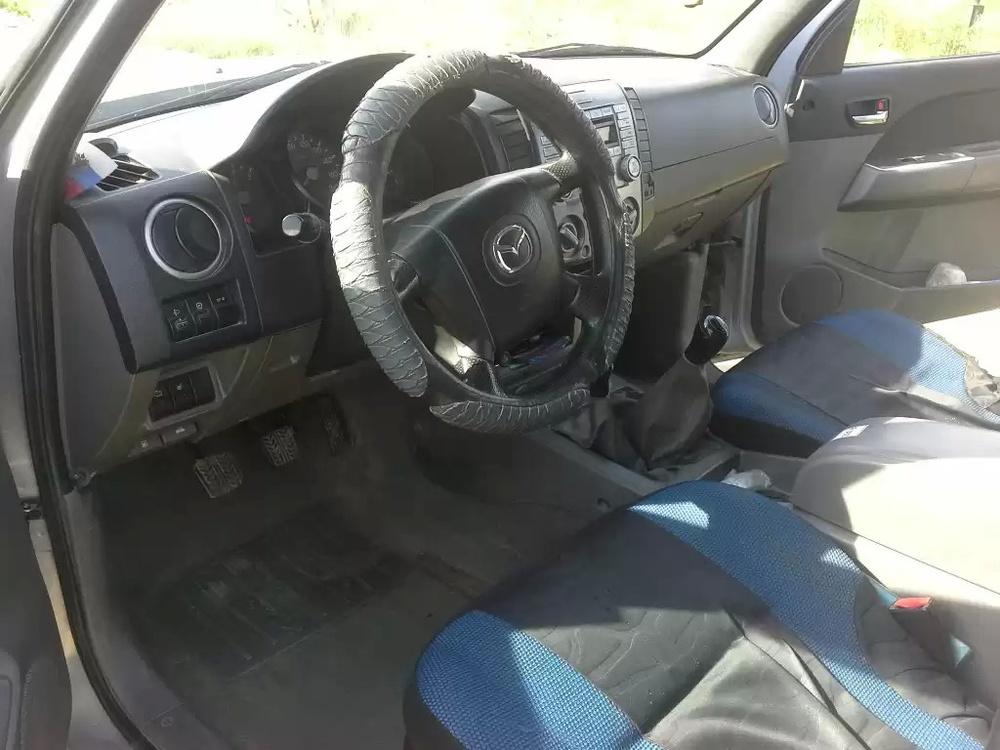 Подержанный Mazda BT-50, отличное состояние, серый , 2007 года выпуска, цена 510 000 руб. в ао. Ханты-Мансийском Автономном округе - Югре