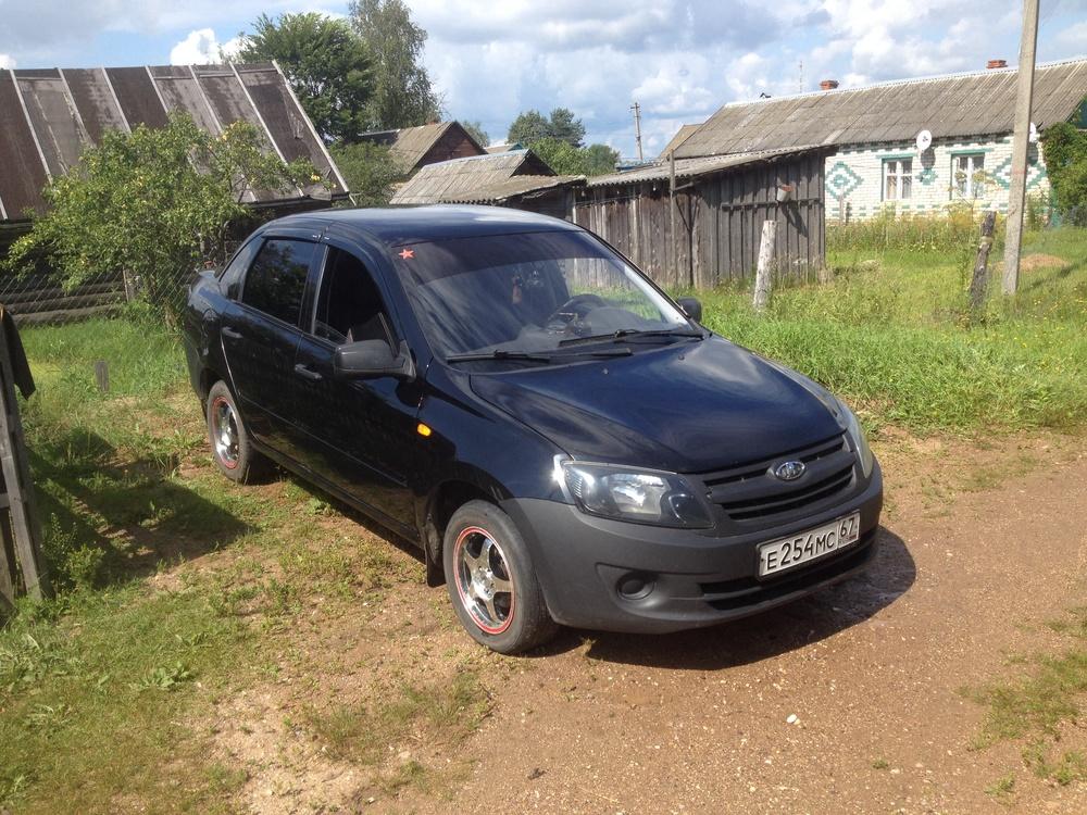 Подержанный ВАЗ (Lada) Granta, хорошее состояние, черный , 2012 года выпуска, цена 280 000 руб. в Смоленской области