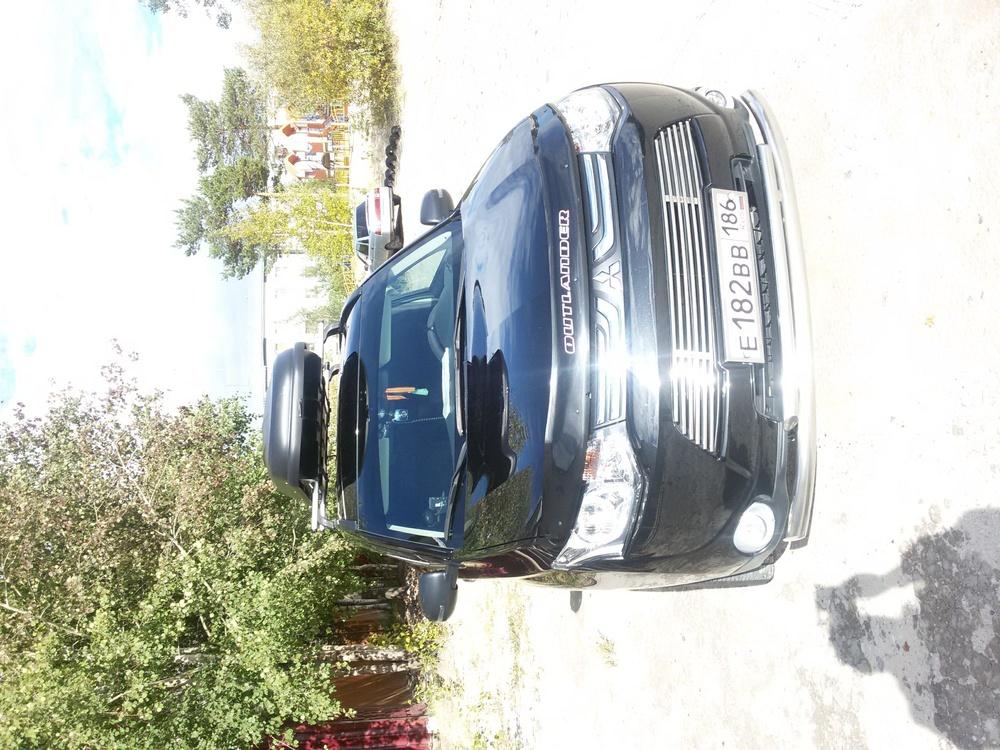 Подержанный Mitsubishi Outlander, отличное состояние, черный , 2013 года выпуска, цена 1 300 000 руб. в ао. Ханты-Мансийском Автономном округе - Югре