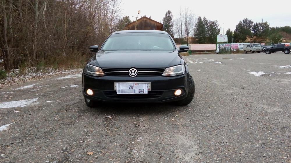 Подержанный Volkswagen Jetta, отличное состояние, черный металлик, 2014 года выпуска, цена 740 000 руб. в ао. Ханты-Мансийском Автономном округе - Югре