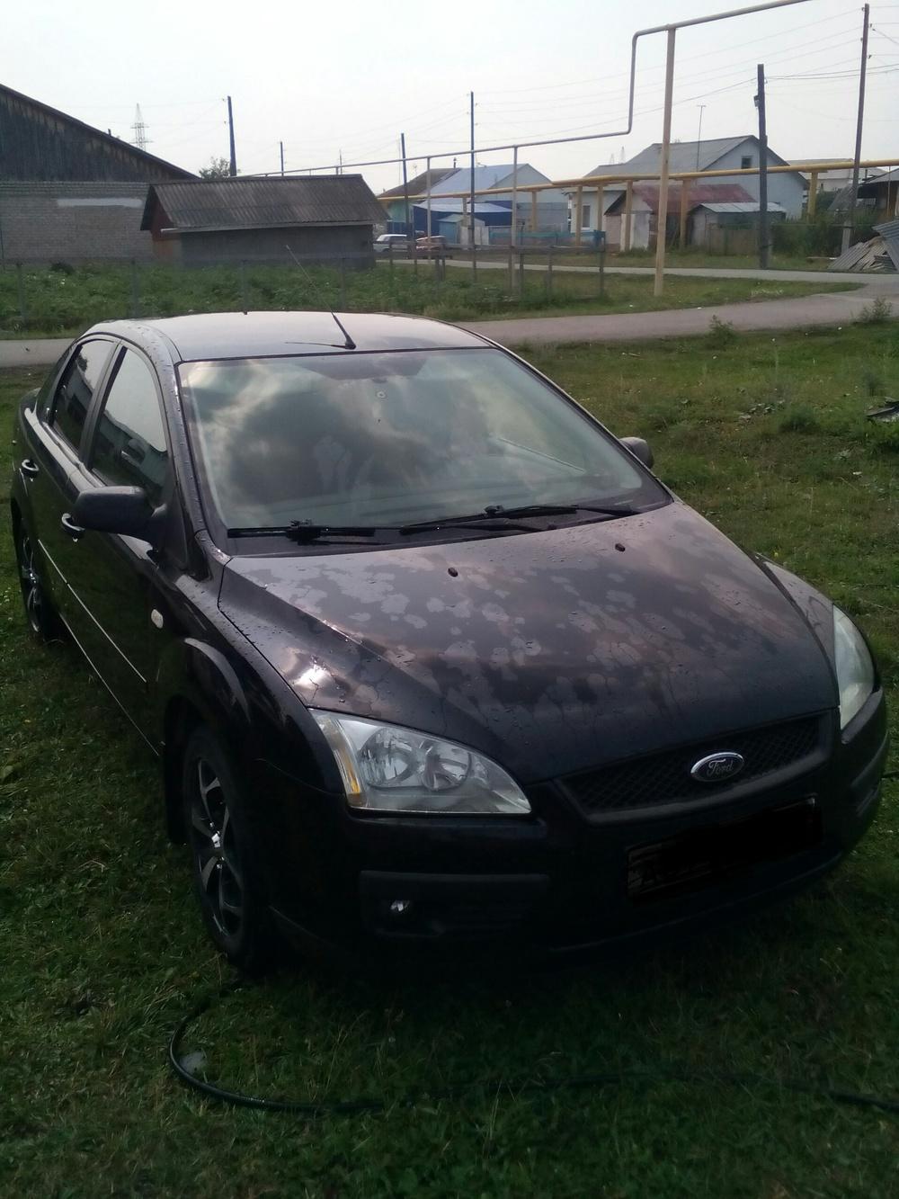Подержанный Ford Focus, хорошее состояние, черный , 2006 года выпуска, цена 290 000 руб. в Челябинской области