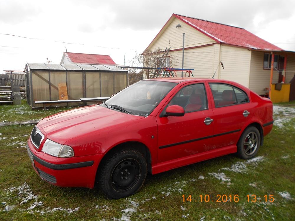Подержанный Skoda Octavia, среднее состояние, красный , 2010 года выпуска, цена 350 000 руб. в ао. Ханты-Мансийском Автономном округе - Югре