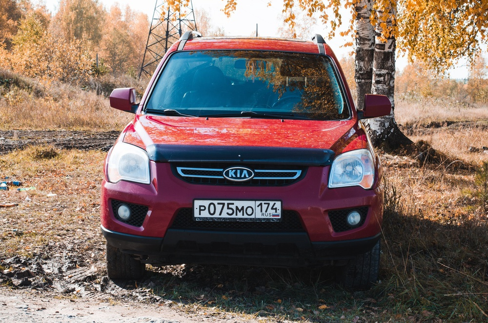 Подержанный Kia Sportage, отличное состояние, бордовый , 2009 года выпуска, цена 700 000 руб. в Челябинской области