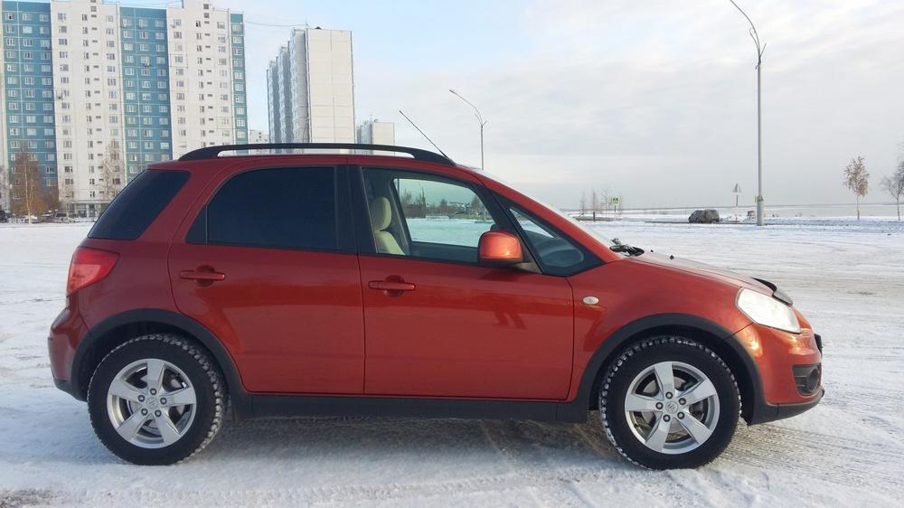 Подержанный Suzuki SX4, отличное состояние, красный металлик, 2013 года выпуска, цена 545 000 руб. в ао. Ханты-Мансийском Автономном округе - Югре
