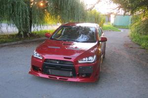 Автомобиль Mitsubishi Lancer Evolution, отличное состояние, 2013 года выпуска, цена 1 440 000 руб., Владивосток
