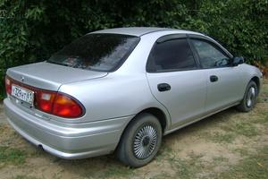 Автомобиль Mazda Familia, отличное состояние, 1997 года выпуска, цена 100 000 руб., Волгодонск