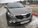Подержанный Kia Sportage, коричневый , цена 700 000 руб. в ао. Ханты-Мансийском Автономном округе - Югре, хорошее состояние
