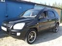 Подержанный Kia Sportage, черный , цена 530 000 руб. в ао. Ханты-Мансийском Автономном округе - Югре, хорошее состояние