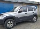 Подержанный Chevrolet Niva, серый металлик, цена 275 000 руб. в ао. Ханты-Мансийском Автономном округе - Югре, хорошее состояние